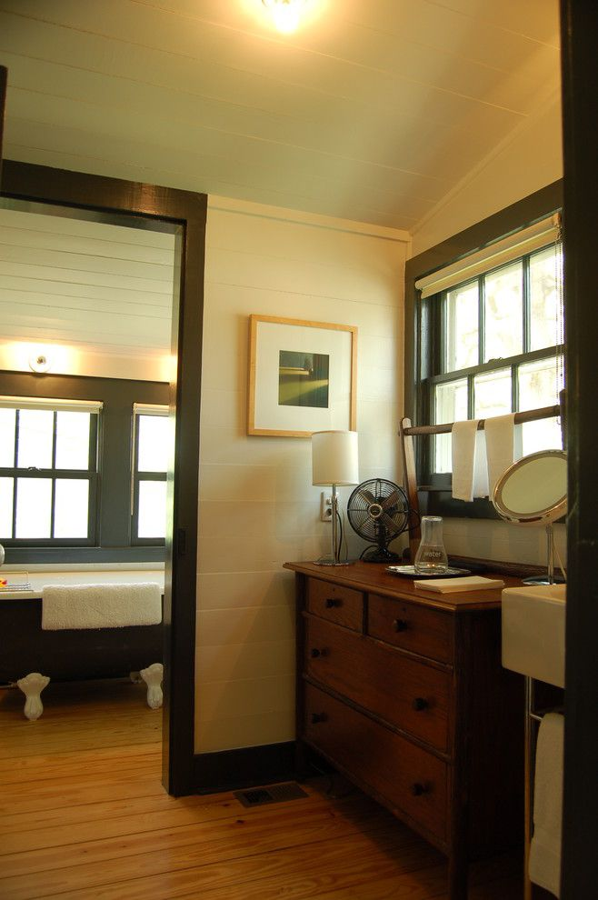 Painted Wood Paneling for a Farmhouse Bathroom with a Claw Foot Tub and Historic House by Tim Cuppett Architects