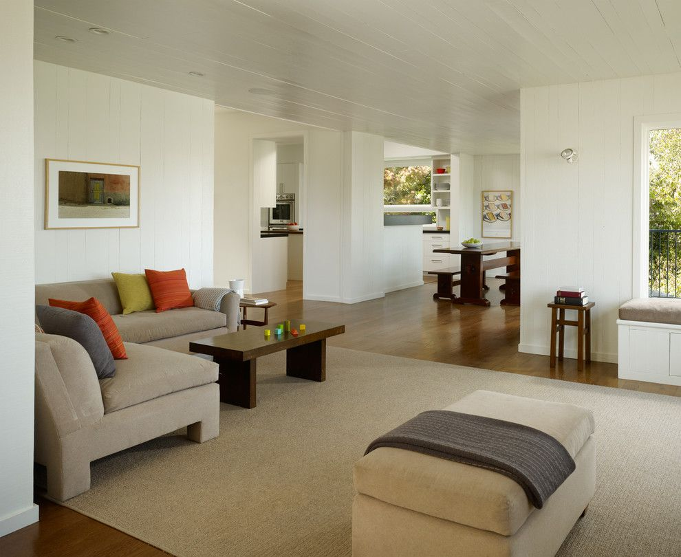 Painted Wood Paneling for a Transitional Living Room with a Storage Bench and Cary Bernstein Architect Potrero House by Cary Bernstein Architect