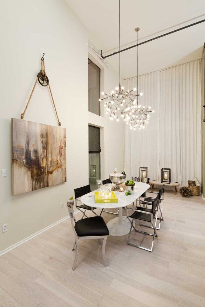 Painting Baseboards for a Contemporary Dining Room with a Oval Dining Table and Venice Loft by Susan Manrao Design