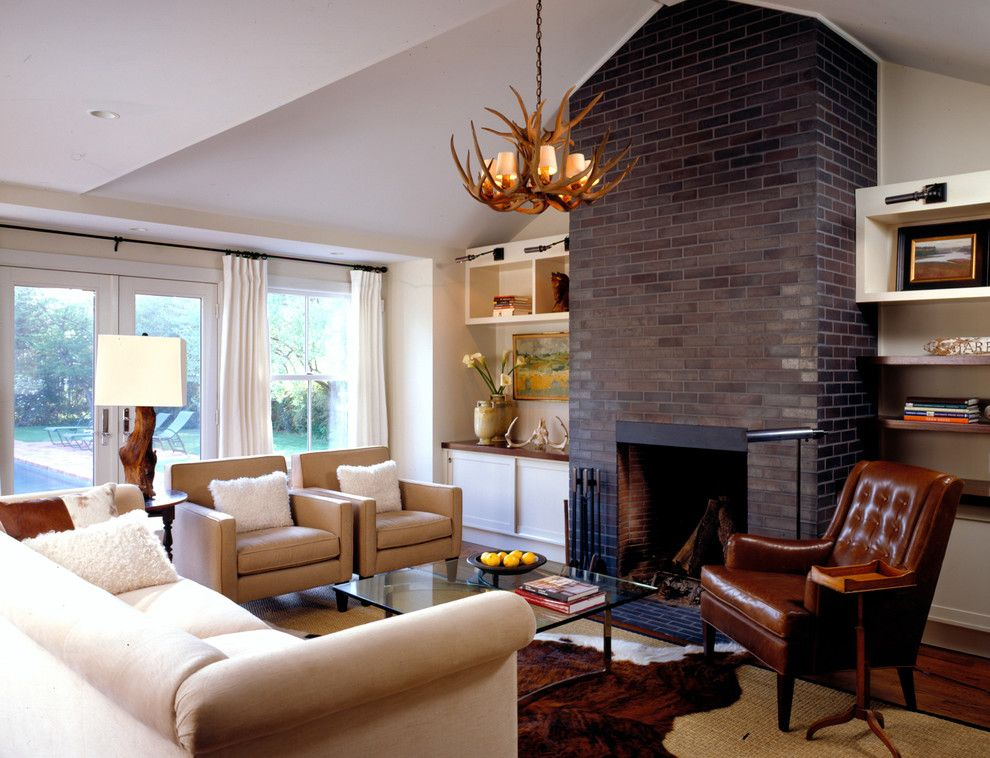 Painting Brick Fireplace for a Farmhouse Family Room with a Sloped Ceiling and Family Room by Paul Rice Architecture