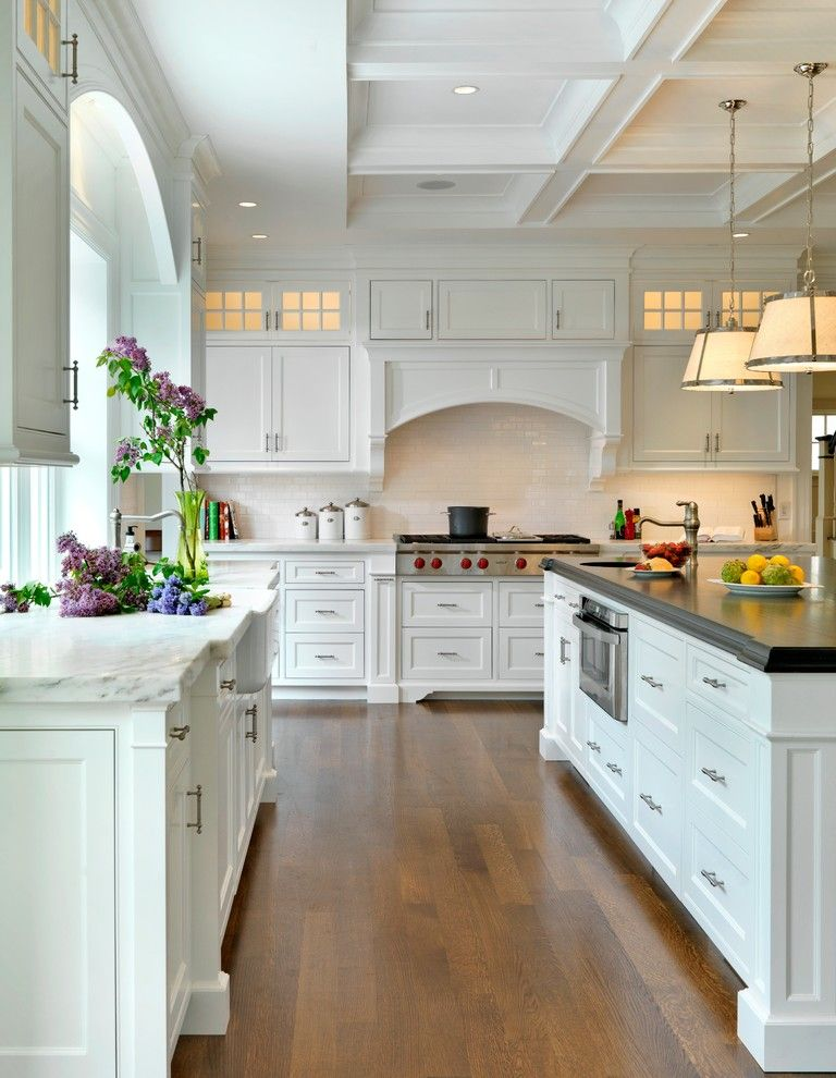 Painting Oak Cabinets for a Traditional Kitchen with a Island and Kitchens by Jan Gleysteen Architects, Inc