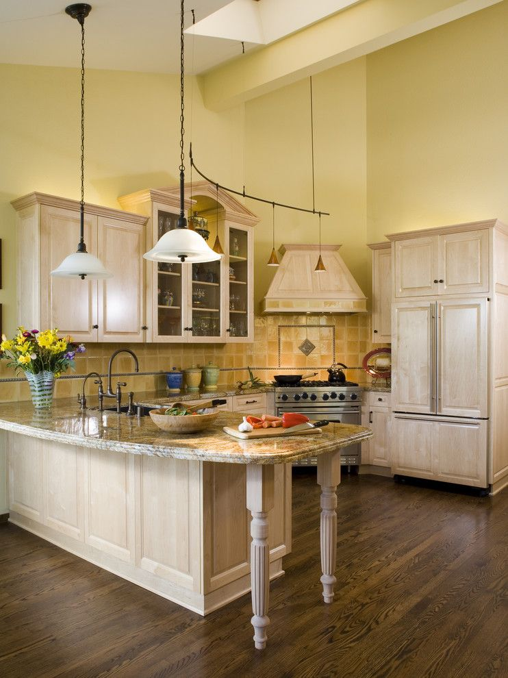 Painting Oak Cabinets for a Traditional Kitchen with a Refrigerator and Kitchen by Harrell Remodeling