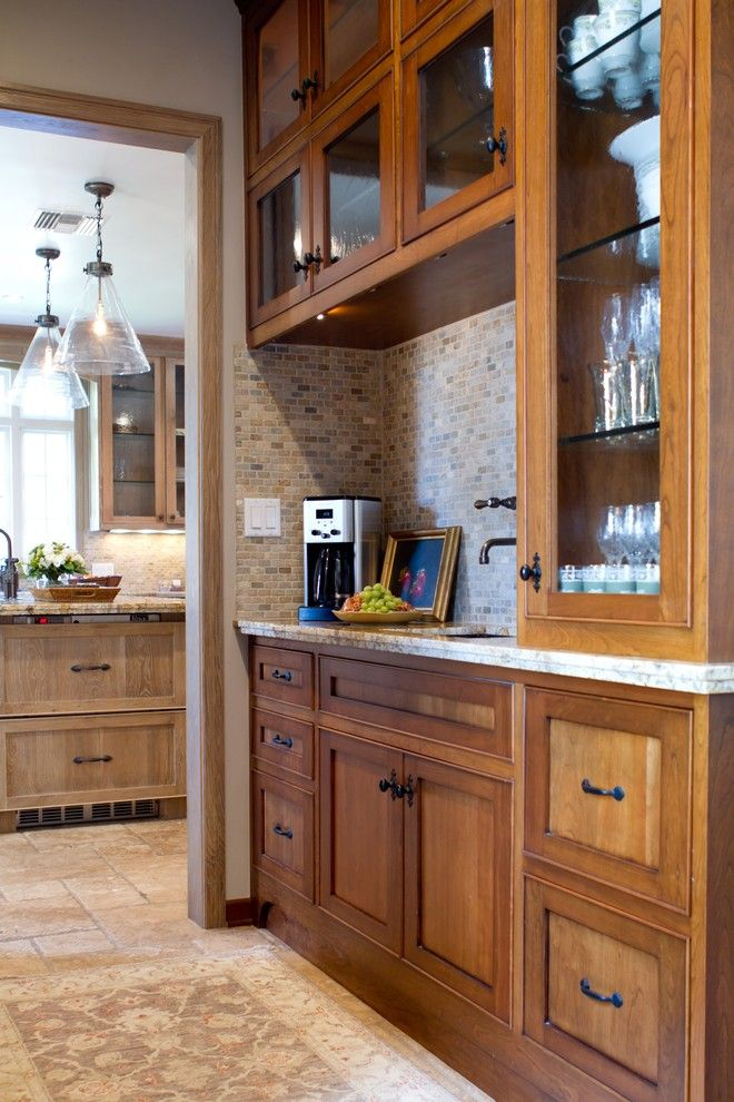 Painting Oak Cabinets for a Traditional Kitchen with a Travertine Floors and Charmean Neithart Interiors, Llc. by Charmean Neithart Interiors, Llc.