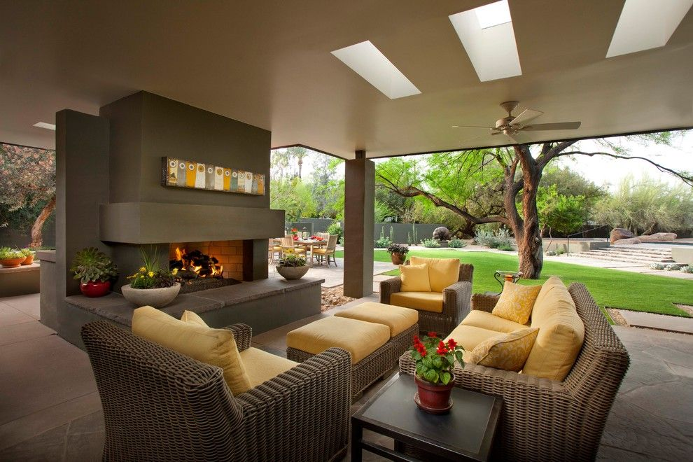 Painting Wicker Furniture for a Contemporary Patio with a Ceiling Fan and Fireplace by Exteriors by Chad Robert