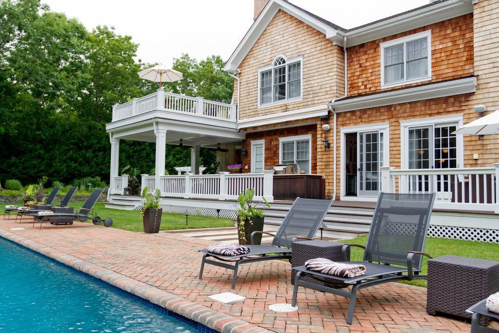Palladian Window for a Traditional Exterior with a Brown Planters and My Houzz: Iris Dankner by Rikki Snyder