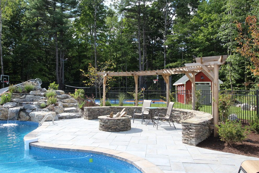 Pallet Shed for a Rustic Patio with a Fire Place and Outdoor Oasis by Flatbrook & Co