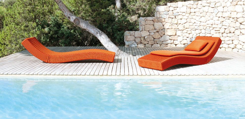 Paola Lenti for a Contemporary Pool with a Stone Retaining Wall and Xave Lounge Chair by Paola Lenti by Escale Design