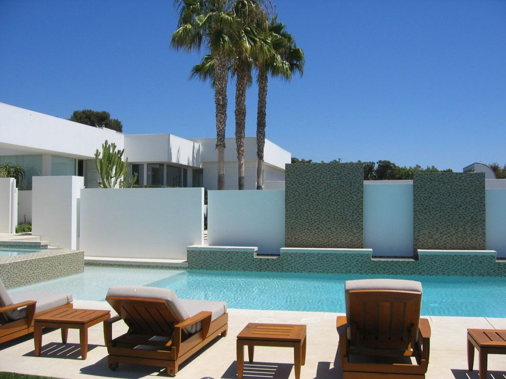 Parapet Wall for a Modern Pool with a Flat Roof and Malibu Residence by Sage Design Studios, Inc.