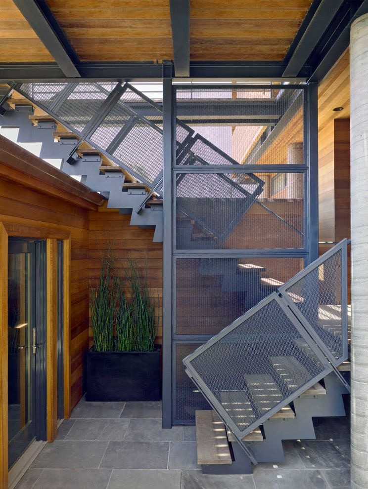Parapet Wall for a Modern Staircase with a Blackened Steel and Stinson Beach House by Irwin Fisher, Inc.