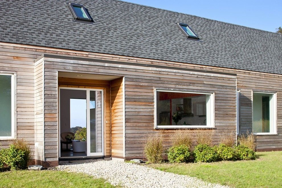 Passive Solar House Plans for a Farmhouse Entry with a Side Lite and Passive House Retreat by Zeroenergy Design