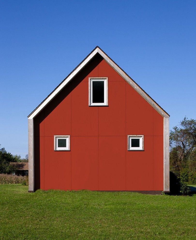 Passive Solar House Plans for a Farmhouse Exterior with a Red House and Passive House Retreat by Zeroenergy Design