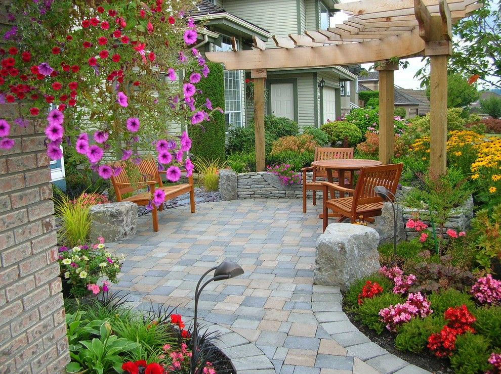 Paver Patterns for a Traditional Patio with a Wood Trellis and Poco by Pacifica Landscape Works Inc.
