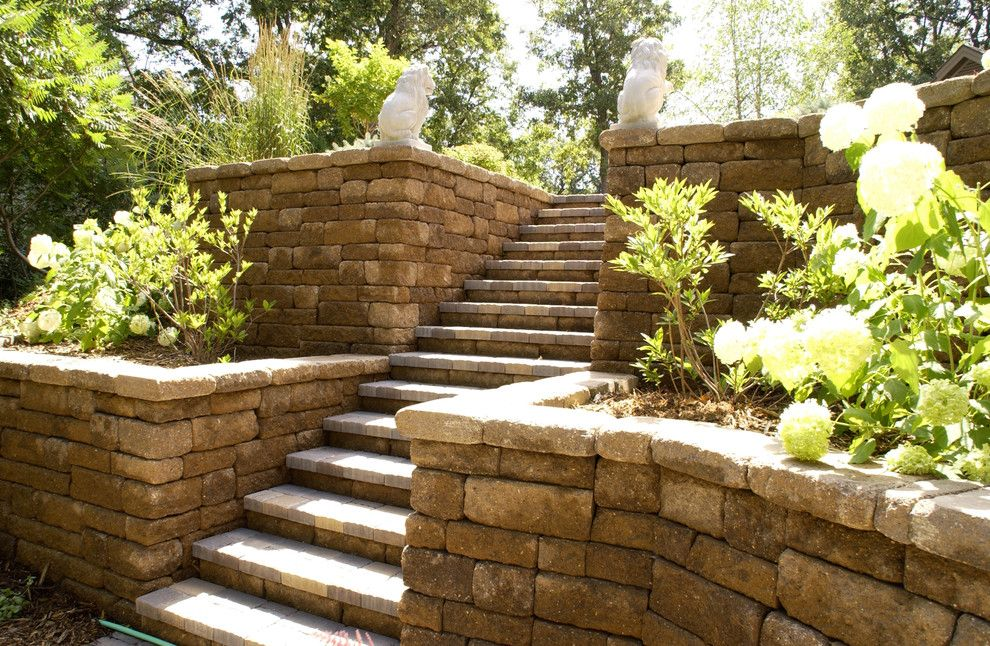 Paver Steps for a Traditional Landscape with a Stone Wall and Retaining Walls by Scenic Specialties