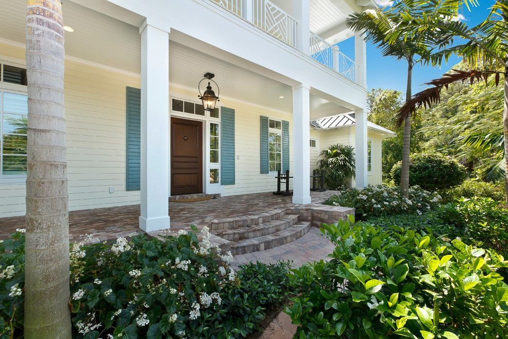 Paver Steps for a Tropical Porch with a Landscape and West Indies House Design by Weber Design Group, Inc.