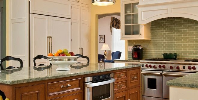 Pawleys Island Posh for a Traditional Kitchen with a Wolf Stove and Spring Kitchen by Teakwood Builders, Inc.