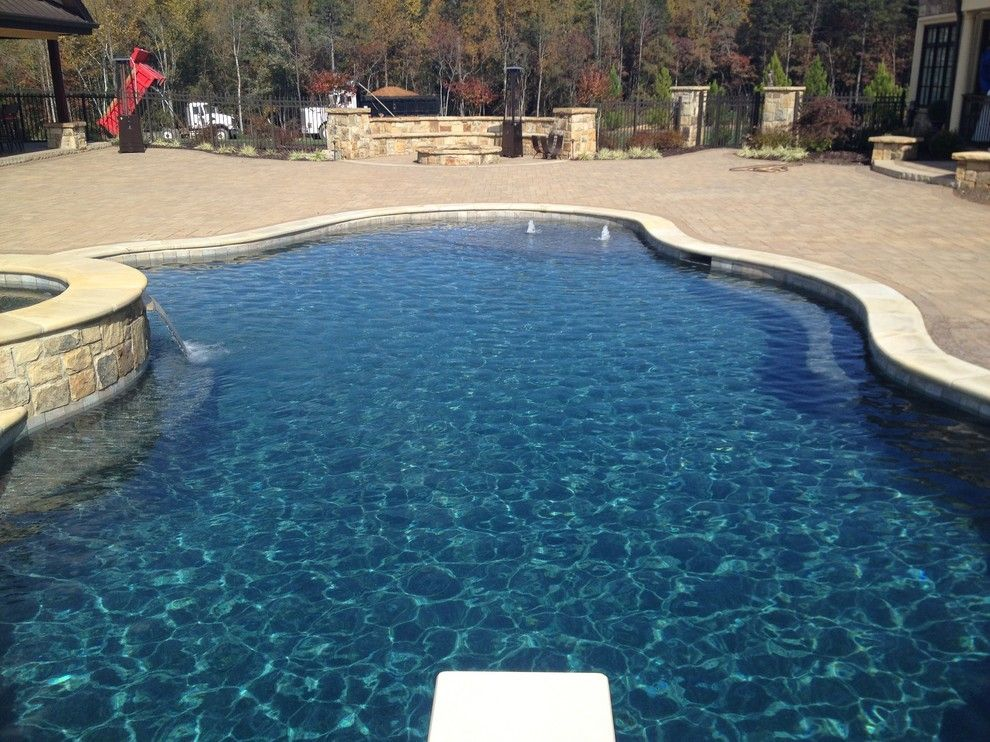 Pebble Sheen for a Mediterranean Pool with a Pebble Sheen and Ocean Blue Pebble Sheen by Vue Custom Pools
