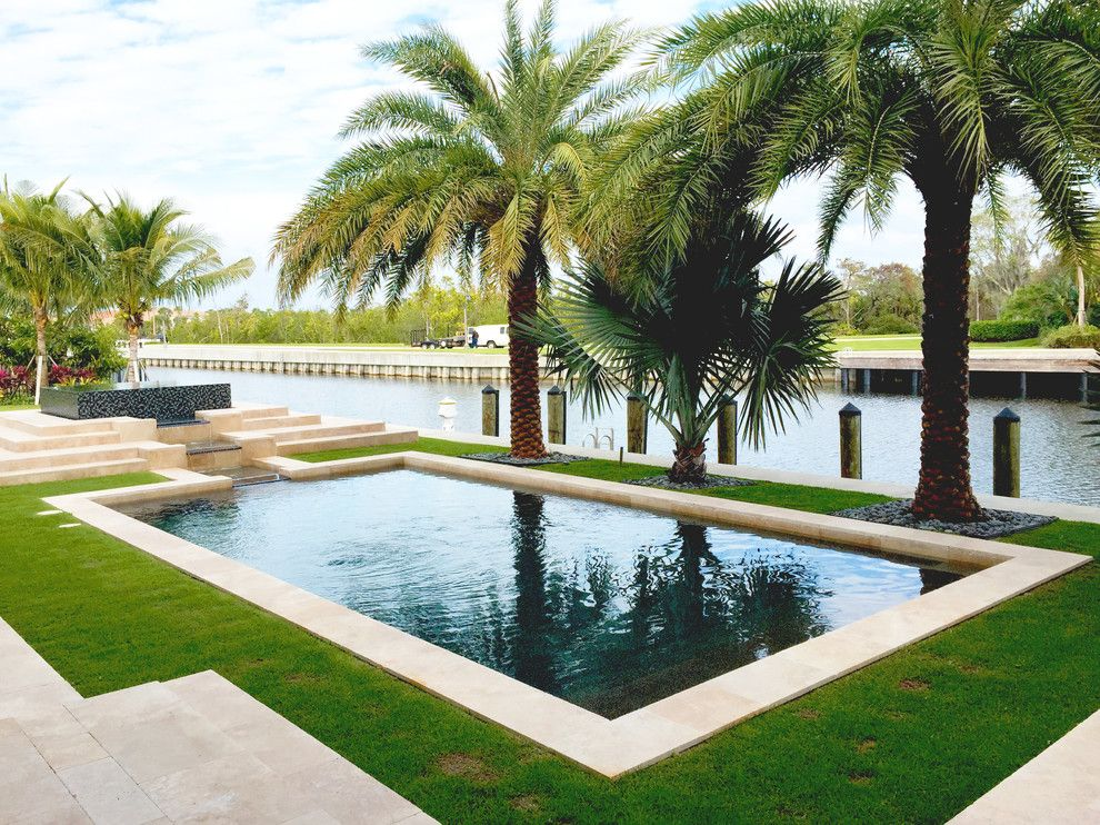 Pebble Tec for a Tropical Pool with a Water View and Our Work by Champion Pools & Spas, Inc.