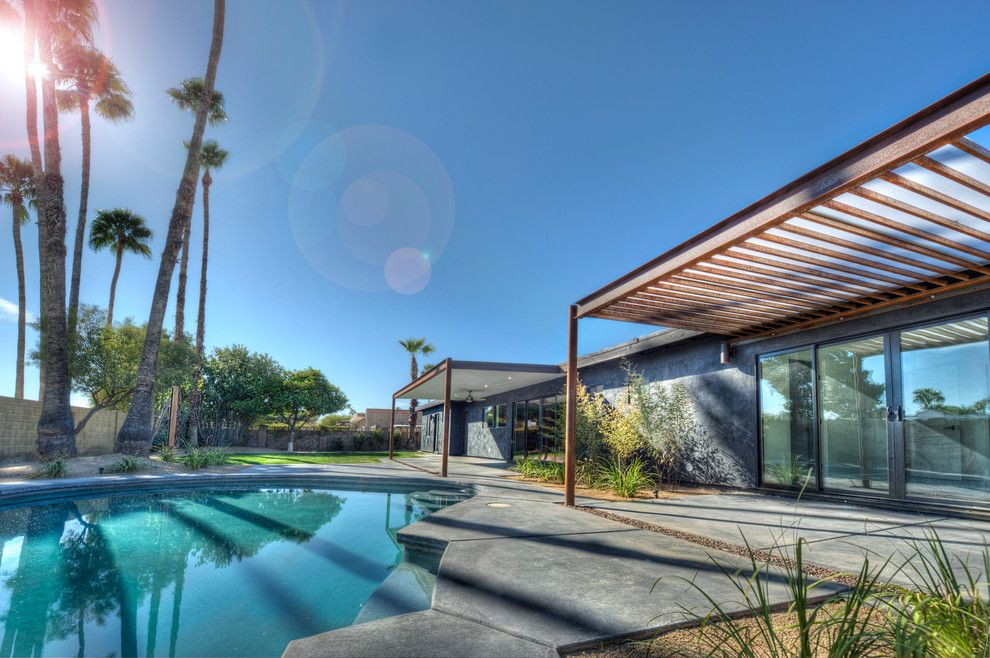 Pebbletec for a Southwestern Exterior with a Patio and Black House (Steinman Renovation) by Spry Architecture