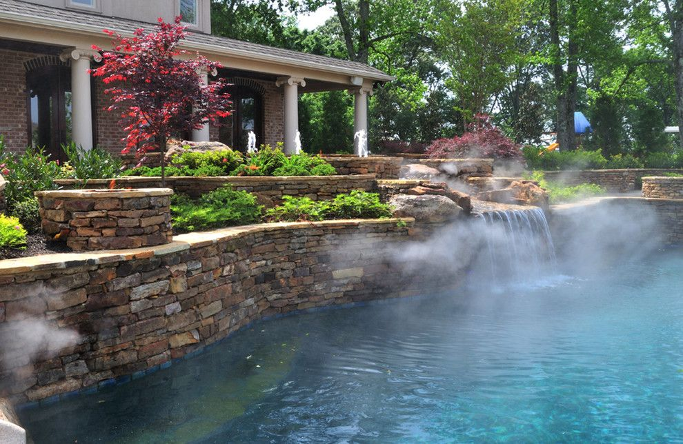 Pebbletec for a Traditional Pool with a Waterslide and Eads Natural Pool & Backyard Resort by J. Brownlee Design