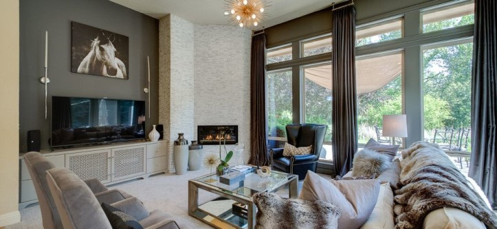 Pella Corporation for a Contemporary Living Room with a Window Treatments and High Contrast Drapery Panels by Budget Blinds
