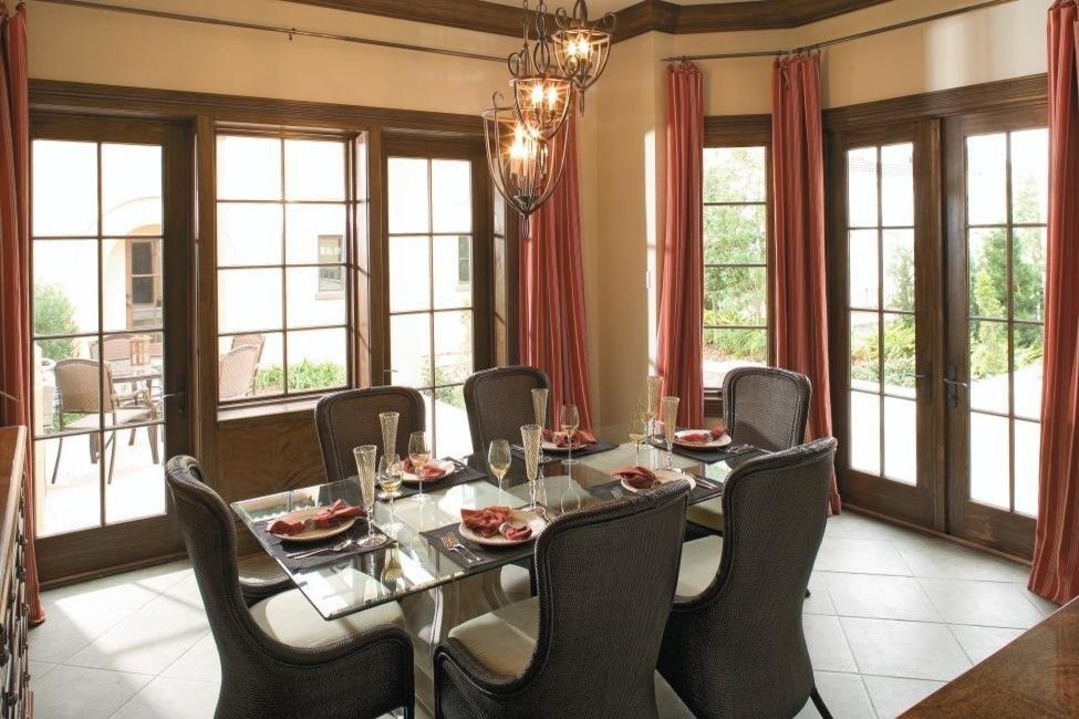 Pella Corporation for a Mediterranean Dining Room with a Single Doors and Stained Wood Doors, by Pella Doors and Windows of Northern California