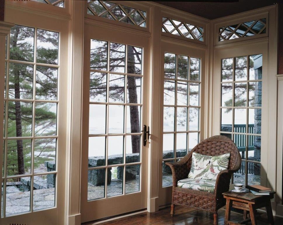 pella corporation for a traditional family room with a patio door and single french wood door