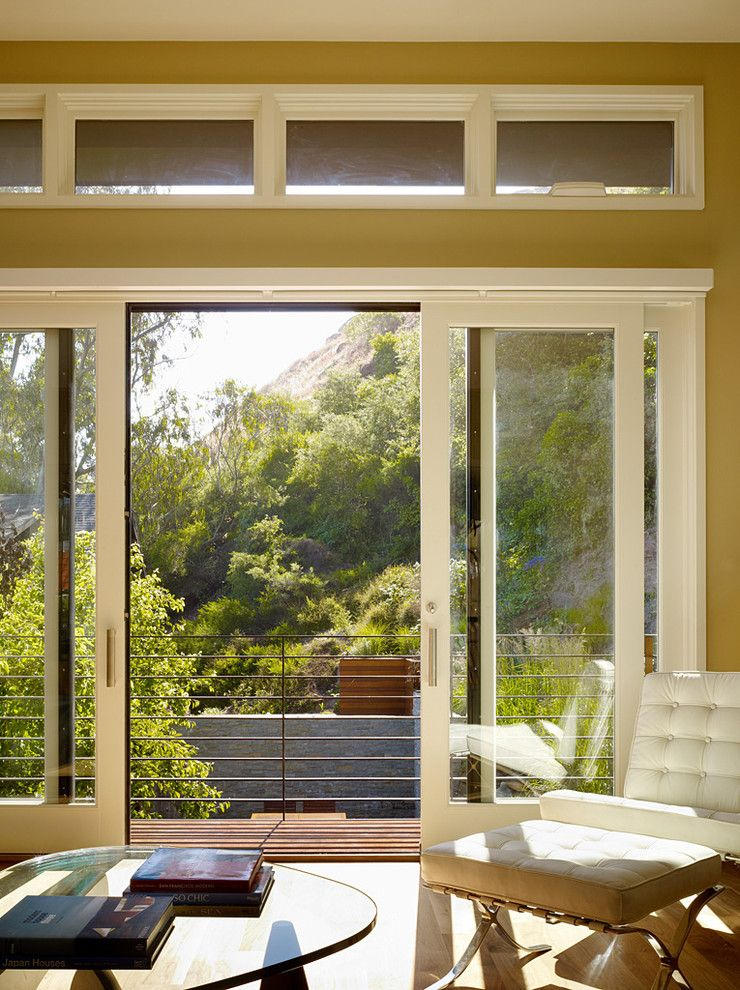 Pella Windows and Doors for a Traditional Living Room with a Glass Doors and Cole Valley Hillside - John Maniscalco Architecture by John Maniscalco Architecture