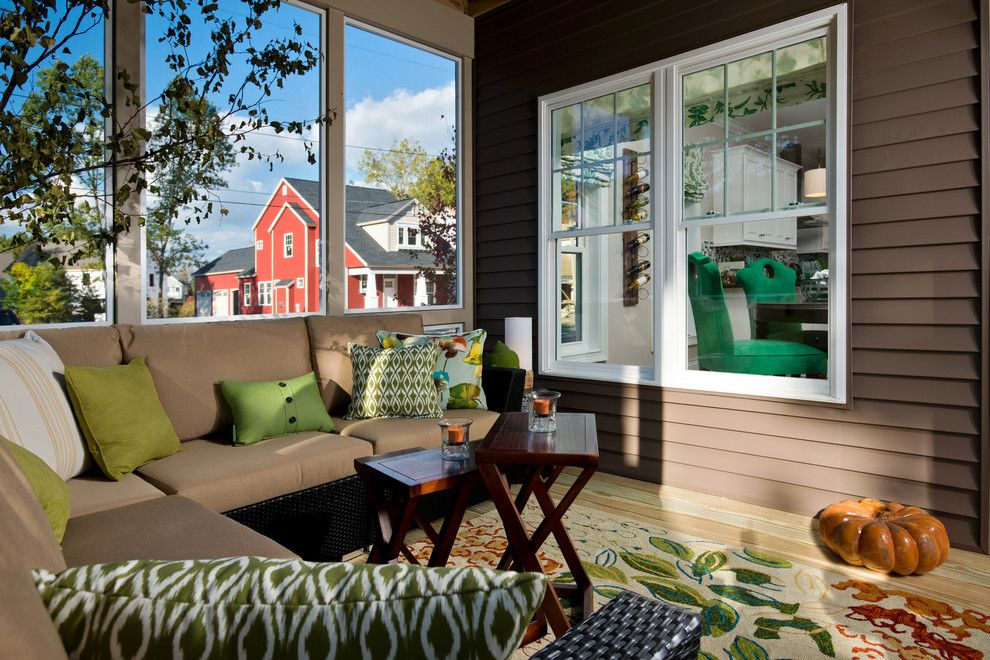 Pella Windows and Doors for a Traditional Porch with a Brown Clapboard Siding and 2013 Showcase of Homes by Belmonte Builders