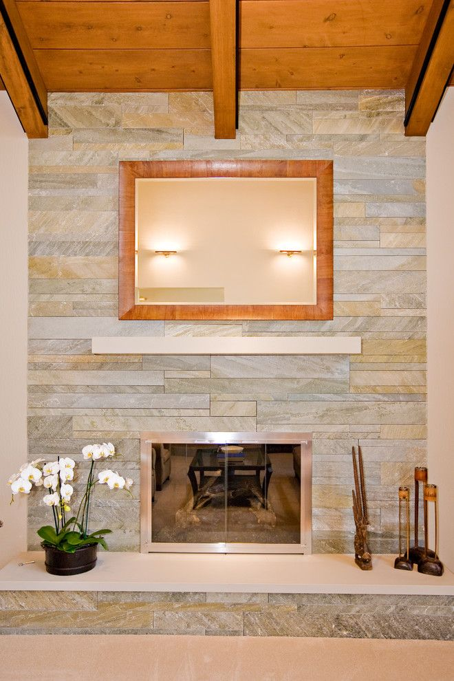 Peninsula Building Materials for a Contemporary Living Room with a Sloped Ceiling and Living Room with Fireplace by Master Stonemason by Bill Fry Construction   Wm. H. Fry Const. Co.