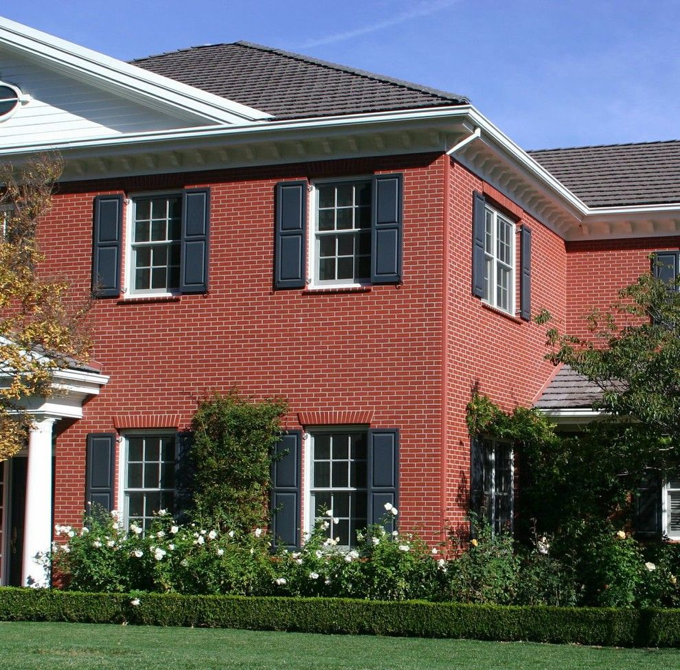 Peninsula Building Materials for a Traditional Exterior with a Brick House and First Impressions, Your Home Entry by Peninsula Building Materials