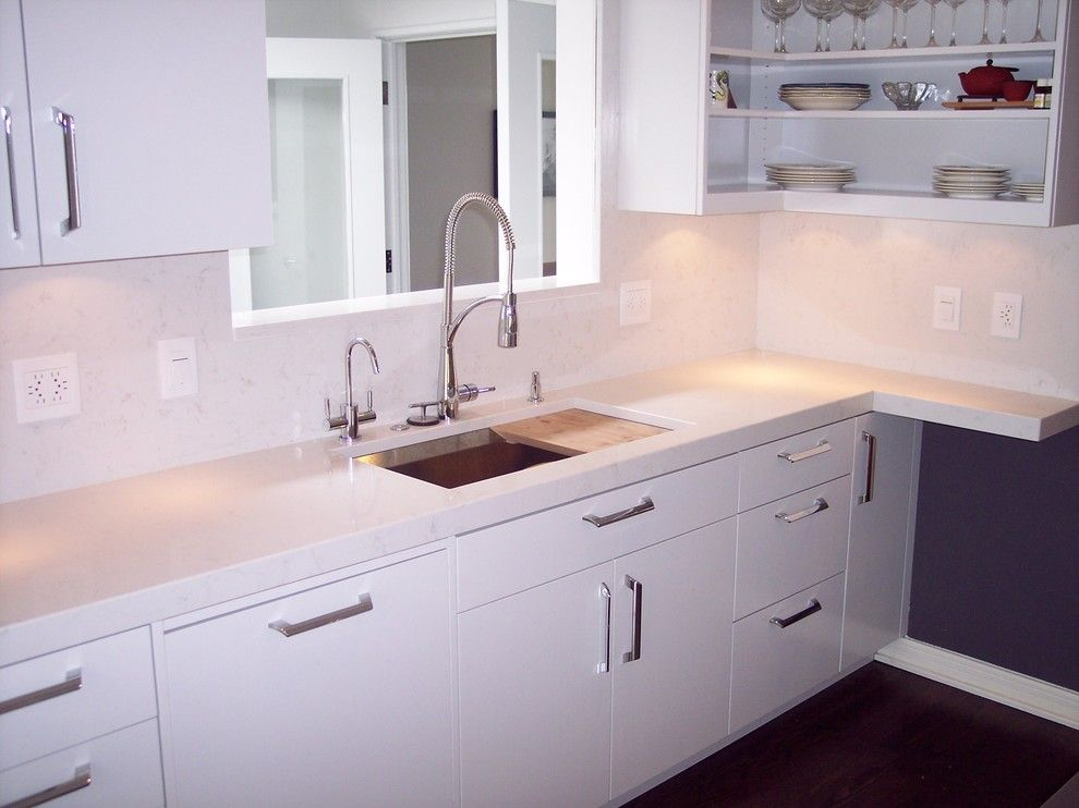 Pental for a  Kitchen with a White Countertop and Pentalquartz in Lattice by Pental Granite & Marble