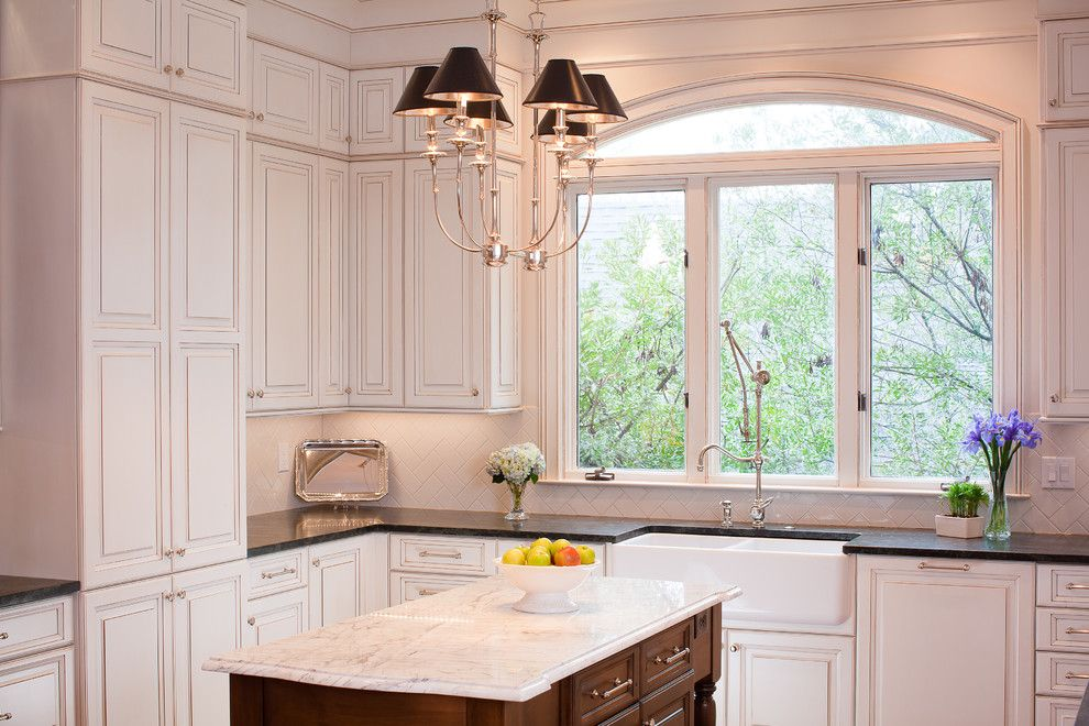 Pental for a Traditional Kitchen with a Arched Window and Kitchen + Bath Artisans by Kitchen + Bath Artisans
