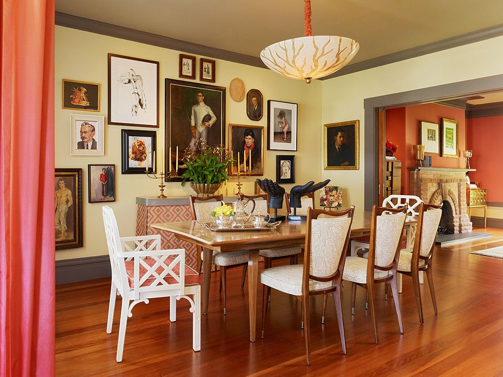 Persimmon Color for a Eclectic Dining Room with a Paintings and Home by Jeffers Design Group