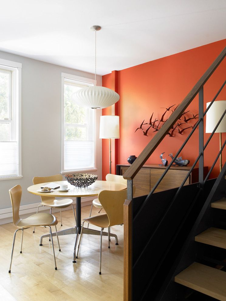 Persimmon Color for a Midcentury Dining Room with a White Painted Trim and Carroll Gardens Abode by Cwb Architects