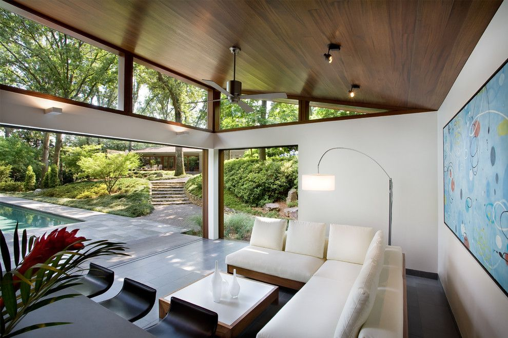 Philip Johnson Glass House for a Modern Patio with a Wood and Nancy Creek Guesthouse and Pool by Philip Babb Architect