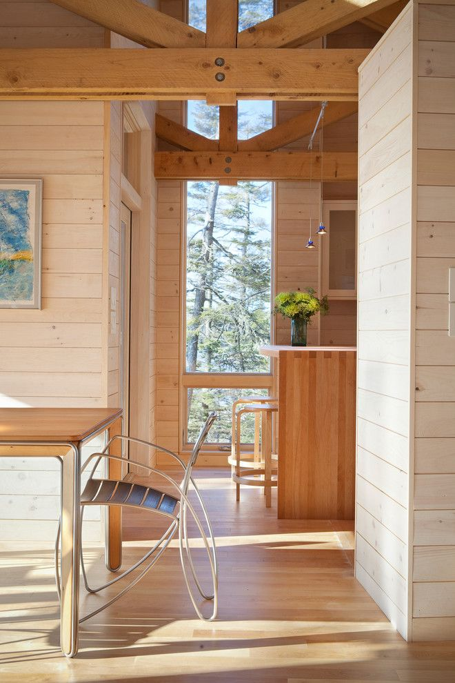 Pine Creek Structures for a Rustic Dining Room with a Tall Windows and Dining and Kitchen by Whitten Architects