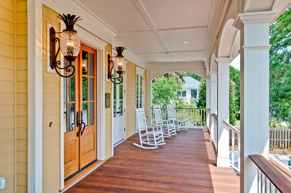 Pineapple Symbolism for a Beach Style Porch with a Beach Style and Front Porch by the Middleton Group
