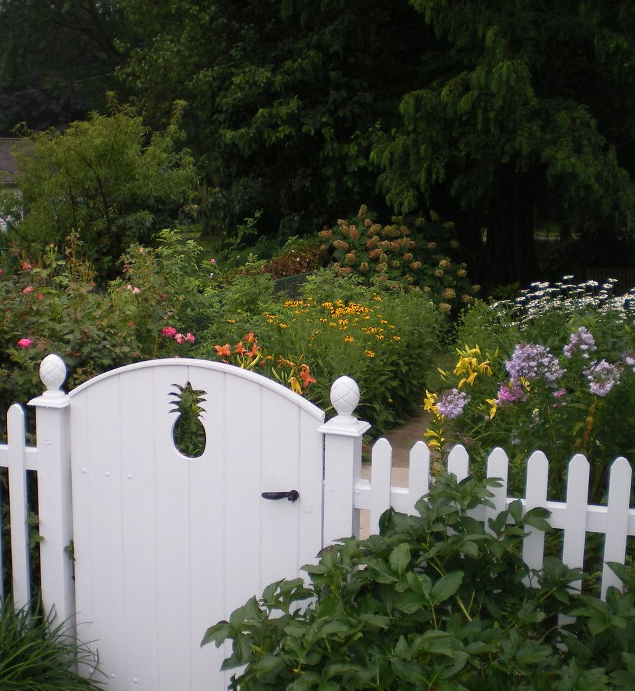 Pineapple Symbolism for a Traditional Landscape with a Gate and Details by Wallace Landscape Associates