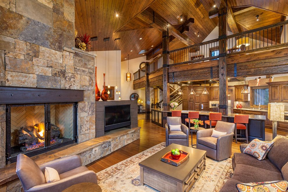 Pinnacle Homes for a Rustic Living Room with a Wood Ceiling and 282 Peerless Drive   Living Room by Pinnacle Mountain Homes
