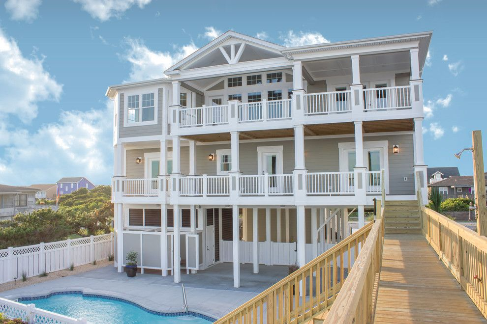 Pittsburgh Paints for a Beach Style Exterior with a Beige Siding and Beach Home 122 by Carolina Bluewater Construction