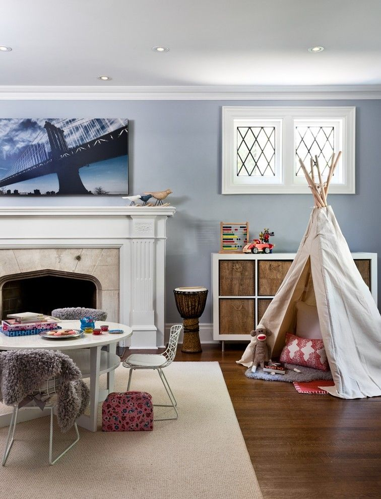 Playrooms for a Eclectic Kids with a Baskets and Chic Mid Town Playroom by Sara Bederman Design
