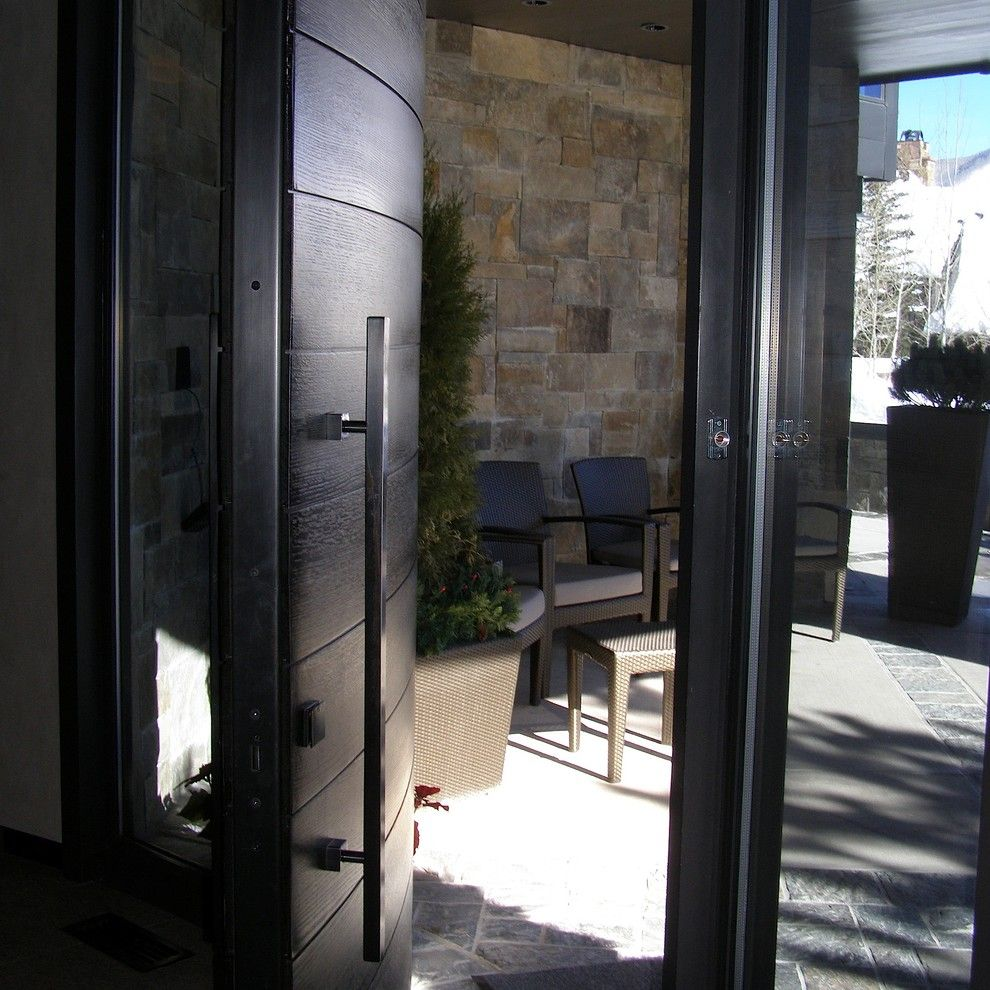 Plummers Furniture for a Contemporary Entry with a Black Door and Plummer Photos by Timothy F. White