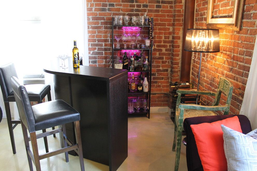 Plummers Furniture for a Eclectic Living Room with a Eclectic and Eclectic Boudoir Inspired Bar by Madison Modern Home
