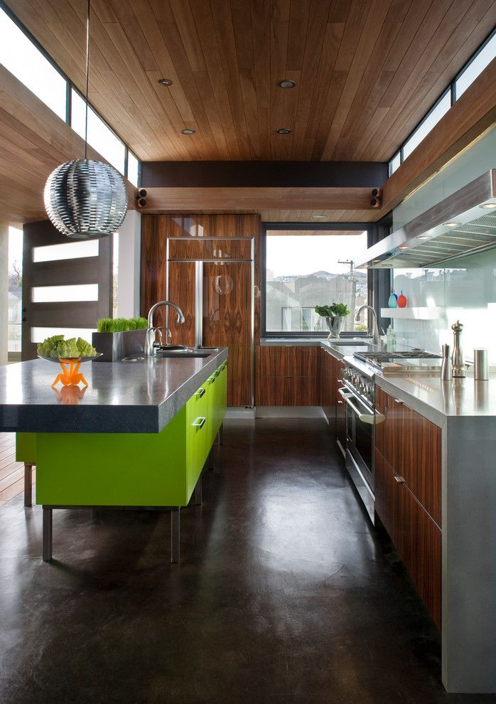 Polished Concrete Countertops for a Contemporary Kitchen with a Cooktop and Sunset Magazine Idea House by Livingston Interiors