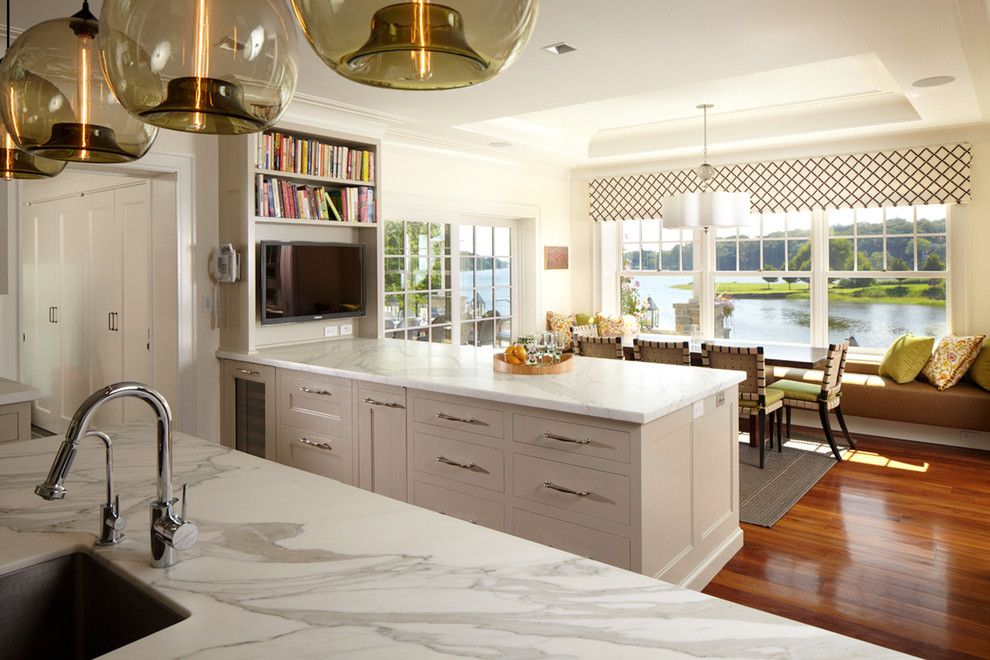 Polished Concrete Countertops for a Transitional Kitchen with a Bench Seating and Greenwich Residence by Leap Architecture