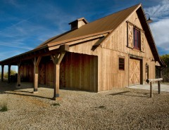 Porter Barn Wood for a Traditional Shed with a Metal Roofing and R.L. Barn by Yellowstone Traditions