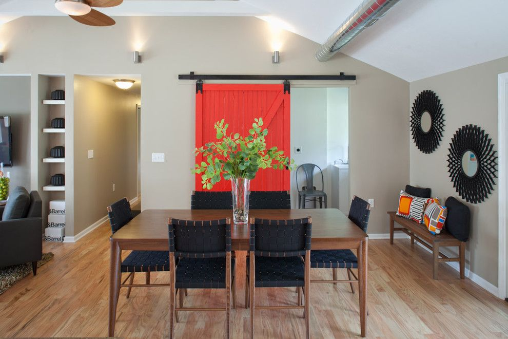 Porter Barn Wood for a Transitional Dining Room with a Bench Seat and Red Barn Door with Full View of Dining Table. by Nest Designs Llc