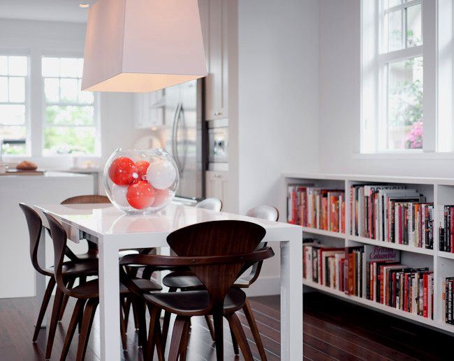 Portico Designs for a Modern Dining Room with a Library and Solo by Portico Design Group