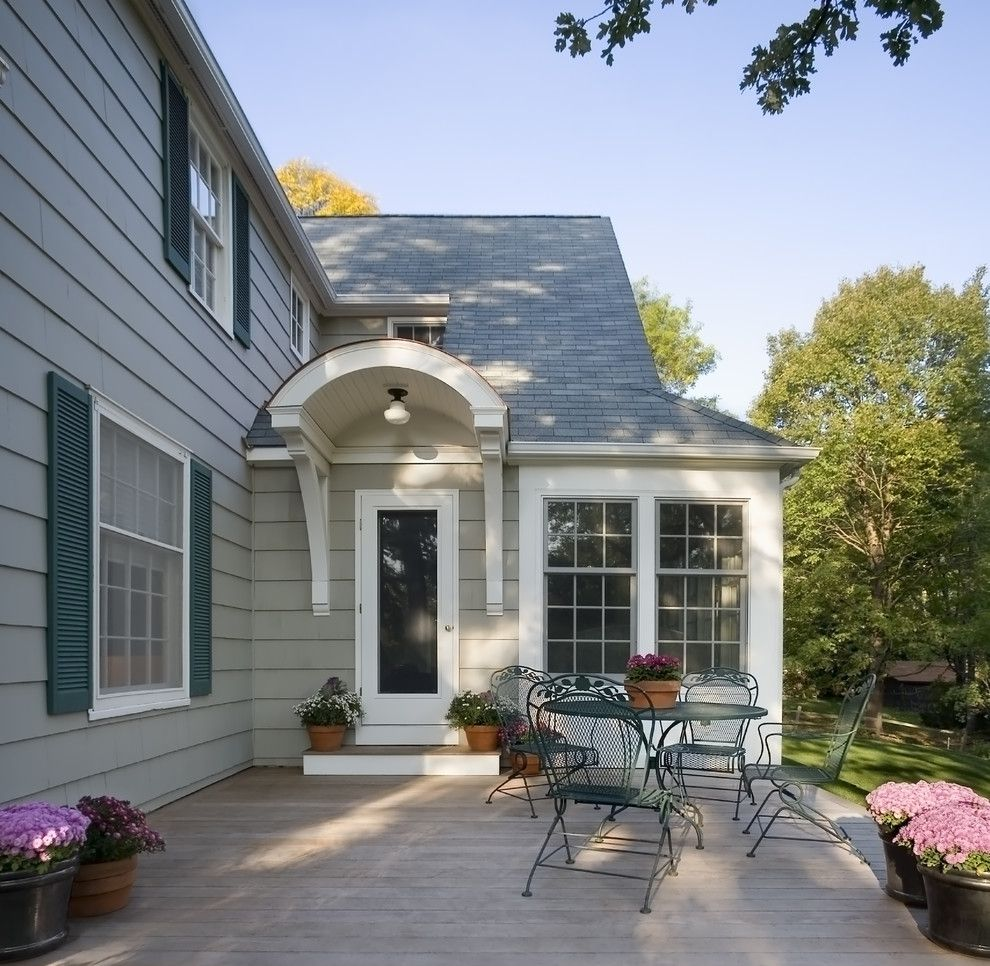 Portico Designs for a Traditional Exterior with a Curved Awning and 1940's Colonial Revival Remodel   Exterior by Trehus Architects+Interior Designers+Builders