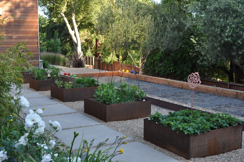 Potager Garden for a Contemporary Landscape with a Step and Bocce Ball Court by Huettl Landscape Architecture